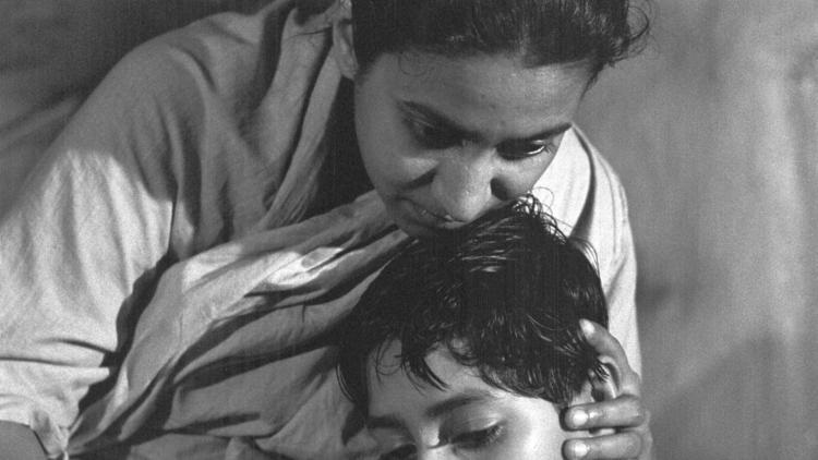 "Pinaki Sengupta as Apu and Karuna Banerjee as Apu's mother, Sarbajaya, in Satyajit Ray's ""Aparajito,"" part of the Apu Trilogy. (Janus Films)"